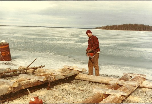 "Building a dock! Skilak is frozen and you can see our ""ice road"" behind Sam as it heads toward Frying Pan Island!"