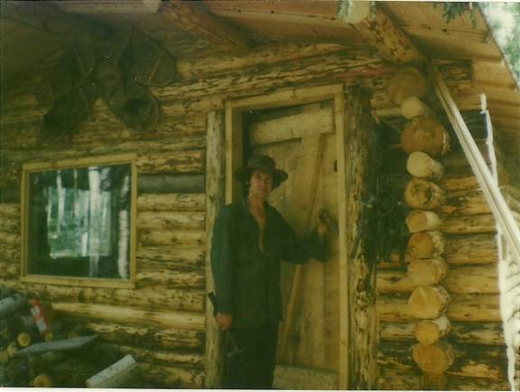 Sam is almost finished hanging the door! A good solid door! Let the cold winds blow, we'll be snug and warm in our little cabin home!