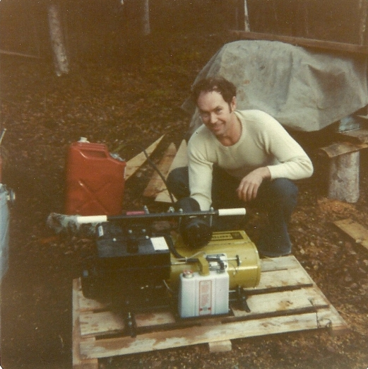 Sam looks pretty happy with his new generator. Used for recharging our radio battery!