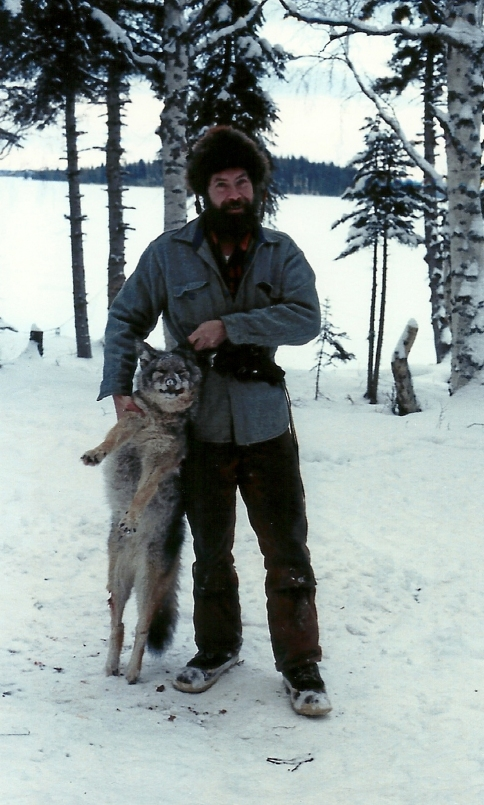 Sam with a coyote he caught. Along with coyote, Sam trapped, mink, otter, beaver and more.